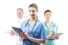 Three competent doctors ready to help Stock Photography