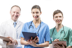 Three competent doctors ready to help Stock Images