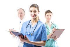 Three competent doctors ready to help Royalty Free Stock Photography
