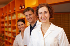 Three competent pharmacists. Smiling in a pharmacy Royalty Free Stock Image