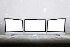 Three computer displays with  white screen for mockup Royalty Free Stock Photos
