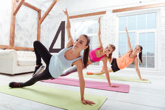 Three concentrated women enjoying sport in gym Stock Images