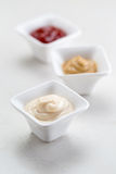 Three Condiment Bowls Royalty Free Stock Photos