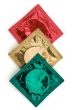 Three Condom Wrappers in Traffic Lights Colors Stock Photos