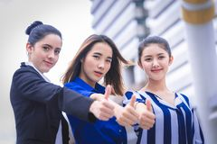 Three confidence woman friend team with thumb up Royalty Free Stock Image