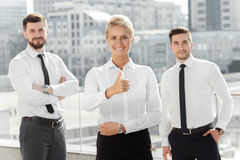 Three confident business partners near office Stock Photos