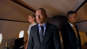 Three confident business people inside of business jet stock video