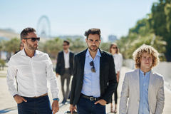 Three confident businessmen walking outside. Portrait of three confident businessmen walking outside Stock Images