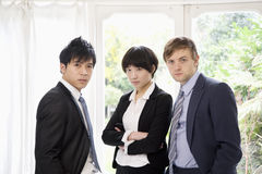 Three confident businesspeople Stock Images