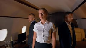 Three confident businesspeople inside of private jet stock video