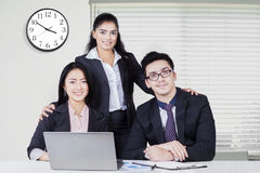 Three confident businesspeople at workplace Royalty Free Stock Photos