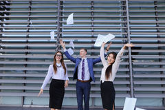 Three confident young people, two women and one men students, en Royalty Free Stock Image