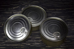 Three conserve can on wooden background stock images
