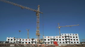 Three construction cranes working on the site stock footage