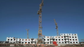 Three construction cranes working on the site stock video footage