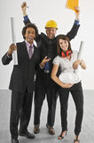 Three construction engineers cheering Stock Photos