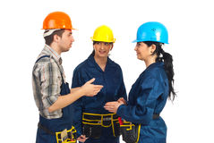 Three constructor workers having conversation. Three constructor workers team having conversation isolated on white background Stock Image