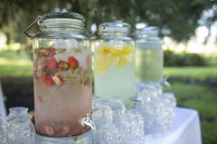 Cold fruit water at outdoor reception stock images