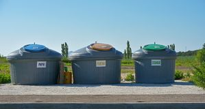 Three containers for sorted waste and blue sky. Three containers for sorted waste stock image