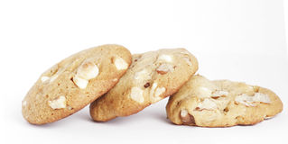 Three Cookie Biscuits With White Chocolate And Nut. Three Cookie Biscuits With White Chocolate And Macadamia Nuts, Plain Background royalty free stock photos