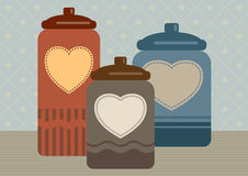 Three cookie jars with hearts Stock Photo