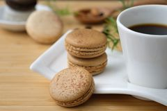 Three Cookies Beside Cup of Coffee Stock Image