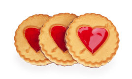 Three cookies with a heart of jelly Royalty Free Stock Photos
