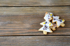 Three cookies in the shape of Christmas trees Royalty Free Stock Photography