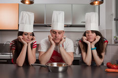 Three Cooks. Group of three friends trying to think of something to cook Stock Images
