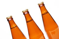 Three cool beer bottle, iIsolated on white. Royalty Free Stock Photo