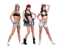 Three cool girls posing in jeans shorts. Isolated on white Royalty Free Stock Image
