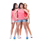 Three cool girls posing in sexy jeans shorts Royalty Free Stock Photography