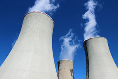 Three cooling concrete towers of power plant Stock Photo