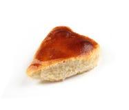 Three-cornered pie. Three-cornered home-made apricot pie over white Royalty Free Stock Photography