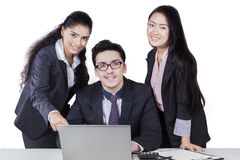 Three corporate workers with laptop isolated Royalty Free Stock Photography