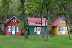 Three cottages. Three small brightly colored cottages in Nida, Lithuania Royalty Free Stock Photo