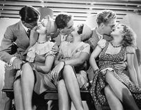Three couples romancing and kissing stock photography