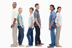 Three couples standing back to back Stock Photography
