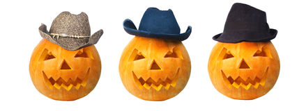 Three cowboy pumpkins. With three different hats Stock Image