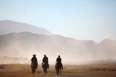 Three cowboys. Three riders on a mountain Royalty Free Stock Photos