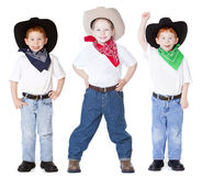Three cowboys Stock Image