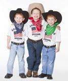 Three cowboys. Three boys dressed up as cowboys in studio stock photo