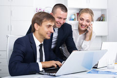 Three coworkers working and talking on phone Royalty Free Stock Photo