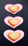 Three crackers on paper hearts Stock Photography