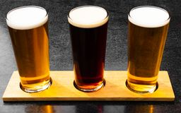 Three craft ales in a row stock images