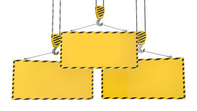 Three crane hooks with blank yellow plates Royalty Free Stock Photos