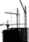 Three cranes and building silhouette royalty free illustration