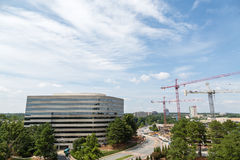 Three Cranes by Concrete Office Royalty Free Stock Photos