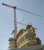 Three cranes overlapping. From below on construction site Royalty Free Stock Photos