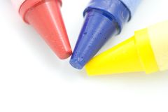 Three Crayons. A photo of three crayons over a white background Stock Image